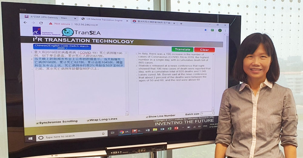 Women in Science: Ms Aw Ai Ti posing with the AI-translation technology behind SG Translate